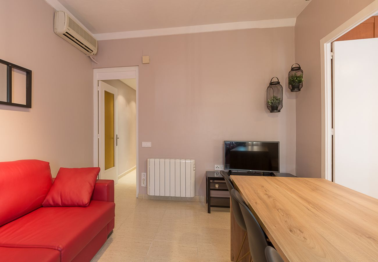 modern living room of the apartment plaza españa in barcelona for holidays